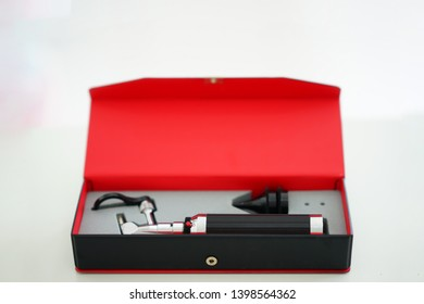 Otoscope for ear check for doctor ENT in block box on blur background