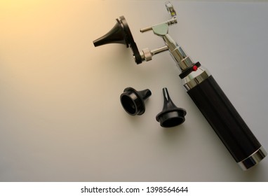 Otoscope for ear check for doctor ENT  with three sizes of specula pieces on blur background with copy space,selective focus