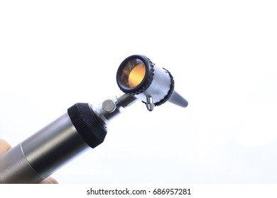 Otoscope on hand  medical equipment technology secialist : use doctor diagnosis eye ,ear, nose disease examination in hospital on white background