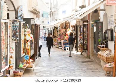 Otranto, Apulia, Italy - MAY 2017 - A touristic shopping lane within the pedestrian area of Otranto in Italy