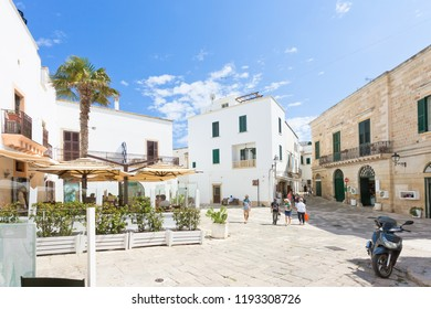 Otranto, Apulia, Italy - MAY 2017 - Some tourists discovering the old town of Otranto in Italy