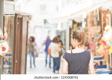 Otranto, Apulia, Italy - A woman walking through the pedestrian zone of Otranto in Italy