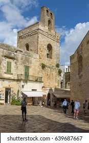Otranto, Italy - September 7, 2016: Tourists in front of Norman bell tower in the historic center of Otranto, a beautiful seaside town on Salento peninsula and popular summer destination in Puglia