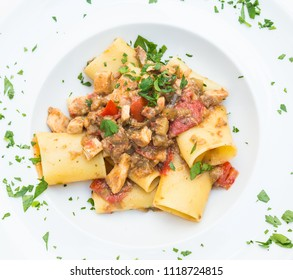 Otranto town, Puglia Region, South of Italy. Traditional Paccheri pasta with Swordfish, served with tomato, parsley, olive oil. Daylight, real restaurant in Otranto.