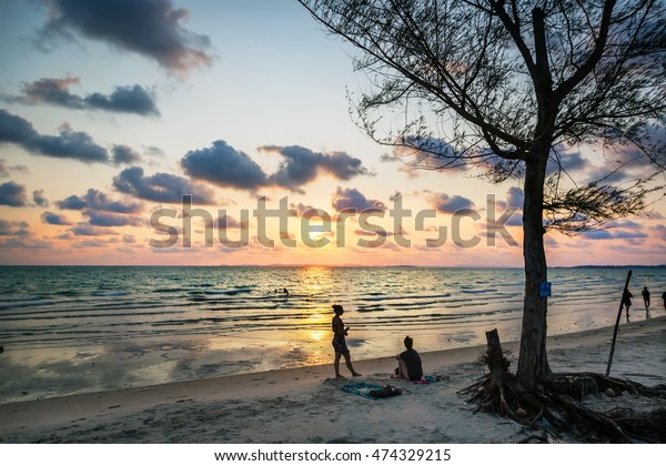 Otres beach, Cambodia - March 29th. 2016 - Tourists enjoying a nice sunset in Otres beach in Cambodia, Asia.