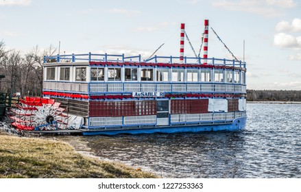Otsego, Michigan, USA - April 26, 2015: The Au Sable River Queen docked on the banks of the famous Au Sable River. The River Queen offers tours of the river through the Huron-Manistee National Forest.