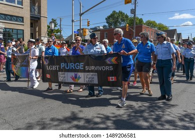 OTTAWA - AUGUST 25, 2019: Uniformed military personnel and other people in civilian clothes are seen participating in the Capital Pride Parade that takes place in Ottawa, capital of Canada.