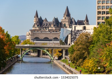Ottawa, CA - 9 October 2019: Banks of the Canal Rideau in the Autumn season & Chateau Laurier in background