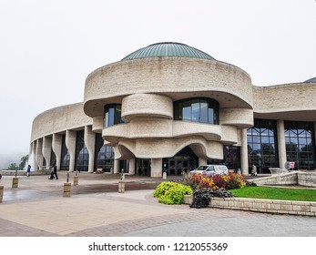 OTTAWA, CANADA - 10 OCTOBER 2018: View of the exterior of the Canadian Museum of History. Located across the Ottawa River from Parliament Hill, the museum was designed by Aboriginal architect Douglas
