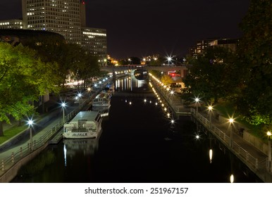 OTTAWA, CANADA - 12TH OCTOBER 2014: The Rideau Canal in Ottawa at night. Boats can be seen