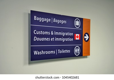 OTTAWA, CANADA -8 MAR 2018- View of a sign for border customs and immigration at the terminal at the Ottawa Macdonald–Cartier International Airport (YOW).