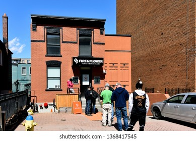 Ottawa, Canada - April 13, 2019: Customers wait in line to enter the Fire & Flower Cannabis store on York St. The store opened April 1 the first day for legal retail store sales in Ontario.