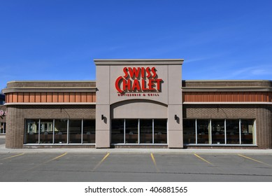OTTAWA, CANADA - APRIL 17, 2016:  Swiss Chalet is a popular casual dining chain.  It was founded in 1954 in Toronto and now has over 200 locations in Canada.