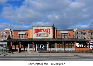 Ottawa, Canada - April 9, 2018:  Canadian restaurant chain Montana's BBQ & Grill on Merivale Rd.  It was originally branded as Montana's Cookhouse, and some locations still use that brand.