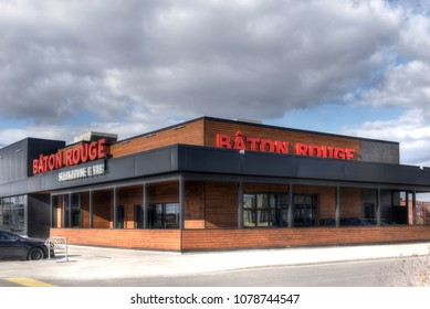 Ottawa, Canada - April 9, 2018:  Canadian restaurant chain Baton Rouge, known for its steaks and ribs, on W Hunt Club Rd.  The chain is headquartered in Montreal, Quebec.