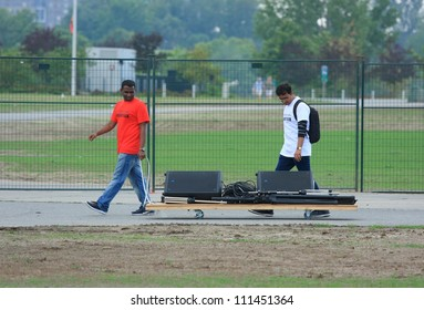 OTTAWA, CANADA  AUGUST 11: Two volunteers moving sound equipment with a dolly at the inaugural Festival of India on August 11, 2012 in Ottawa, Ontario.