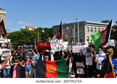 Ottawa, Canada - August 14, 2021:  A crowd gathers at the monument to Canadian Peace Keepers to rally for international help for Afghanistan which is being taken over by the Taliban