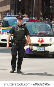 Ottawa, Canada - August 25, 2012: Ottawa Police officer marches in the Capital Pride parade.