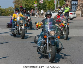 OTTAWA, CANADA - AUGUST 26:  A group of motorcycles taking part in the Capital Pride Parade on August 26, 2012 in Ottawa, Ontario.