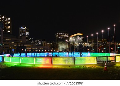 OTTAWA, CANADA - DEC 7, 2017:  People skate on the SENS Rink of Dreams, a skating rink affiliated with the Ottawa Senators, located in front of City Hall that provides free skating during the winter.