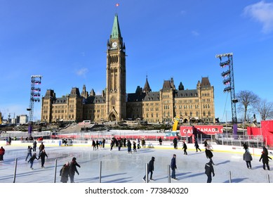 OTTAWA, CANADA - DECEMBER 11, 2017:  The temporary skating rink erected on Parliament Hill as part of the Canadian 150th anniversary celebrations offers free skating to public until February 25, 2018