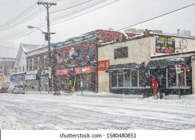 Ottawa, Canada – December 16, 2007: Elgin Street during a blizzard featuring Woody's, Maxwell's and Bouchey's Fruit Mart