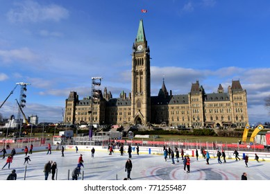 OTTAWA, CANADA - DECEMBER 8, 2017:  The temporary skating rink erected on Parliament Hill as part of the Canadian 150th anniversary celebrations opened to the public the day before.