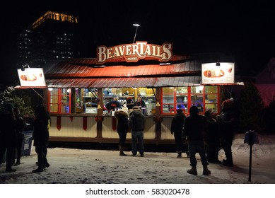 OTTAWA, CANADA FEB 5, 2017: Thousands of people take part in the annual Winterlude Festival and taste the local pastry known as BeaverTails, at Confederation Park.