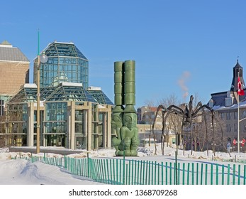 OTTAWA, CANADA, FEBRUARY 17, 2019, Three watchmen and Maman spider sculptures in front of the national gallery in Ottawa, 17 February 2019