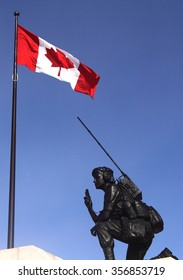OTTAWA, CANADA - FEBRUARY 20, 2012: Reconciliation: The Peacekeeping Monument in Ottawa commemorates the role Canada plays in international peacekeeping and the soldiers who have participated.