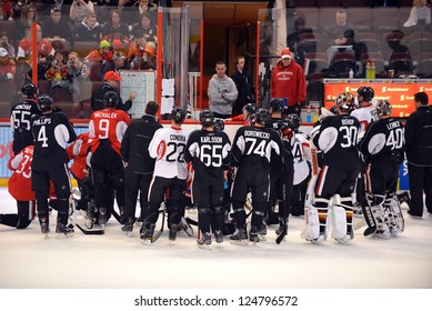 OTTAWA, CANADA  JAN 13:  Coach Paul MacLean instructs the Ottawa Senators as they return to the ice for their first practice of training camp after the NHL lockout  Jan 13, 2013 in Ottawa, Canada.
