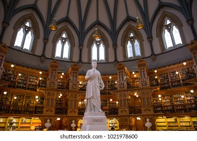 OTTAWA, CANADA - JANUARY 4, 2018: A tall white statue of Queen Victoria stands in the middle of the Library of Parliament.