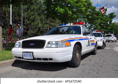 OTTAWA, CANADA - JUL. 1, 2011: RCMP Royal Canadian Mounted Police Ford Crown Victoria Police Car on Parliament Hill in Ottawa, Ontario, Canada.