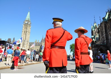 OTTAWA, CANADA - JULY 1, 2011: RCMP Police with antique red uniform solute on Canada Day in the parliament plaza in Ottawa, Ontario, Canada.