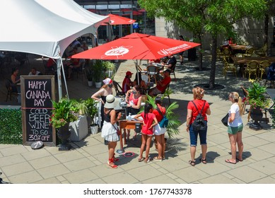 Ottawa, Canada - July 1, 2020: With Canada Day celebrations cancelled due to the Covid-19 pandemic the downtown is less crowded with people only allowed to dine on outdoor patios