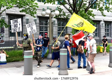 Ottawa, Canada - July 1, 2020: Pro-gun and covid lockdown protesters protest in front of the US Embassy.