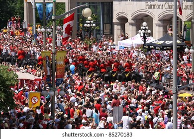 OTTAWA, CANADA – JULY 1: Royal Canadian Mounted Police ride horses on July 1, 2011 through downtown Ottawa, Ontario. They were escorting Will and Kate on Canada Day during their royal visit to Canada.