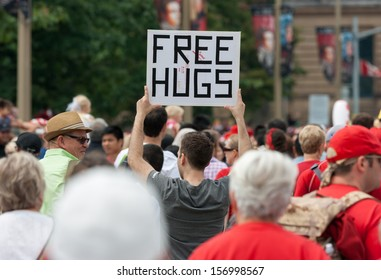 OTTAWA, CANADA - JULY 1: A young man offering free hugs during Canada Day on July 1, 2013 in downtown Ottawa, Ontario.