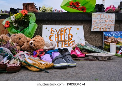 Ottawa, Canada. June 1, 2021. Memorial in tribute to 215 aboriginal children whose remain found in Residential School in Kamloops. Every Child Matters sign by Toys and shoes dropped in memory
