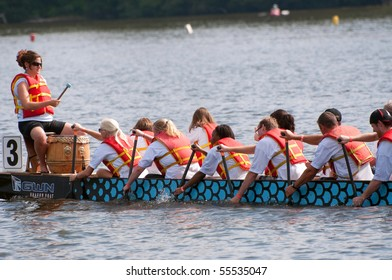 OTTAWA, CANADA - JUNE 19: Dragon Boat team in action at the Dragon Boat Race festival June 19, 2010 in Ottawa, Ontario.