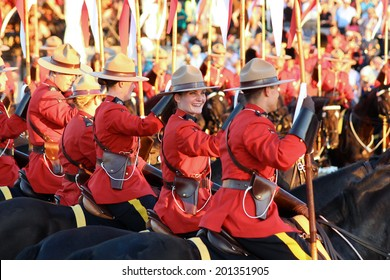 OTTAWA, CANADA - June 26, 2014: The Royal Canadian Mounted Police (RCMP) Musical Ride performs in Ottawa, Canada, during the Sunset Ceremonies.