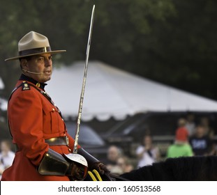 OTTAWA, CANADA - JUNE 27, 2013: Superintendent Marty Chesser of the Royal Canadian Mounted Police (RCMP) leads the Musical Ride to its Sunset Ceremony performance on June 27, 2013.