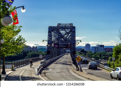 Ottawa, Canada - June 28, 2018: Alexandra Bridge is a steel bridge that crosses Ottawa river, connecting Ottawa city (Ontario) wiht Gatineau city (Quebec). It was officially inaugurated in 1901.