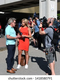 Ottawa, Canada - June 7, 2019:  CTV reporter Christina Succi interviews Sean McKenney, President of Ottawa and District Labour Council, at  protest for Ontario Premier Doug Ford.
