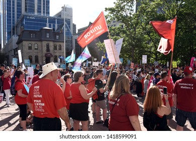 Ottawa, Canada - June 7, 2019:  Crowd gathers outside the courthouse to protest the moves made by Ontario Premier Doug Ford after his first year in power.  Ford has been taking a hit in recent polls.