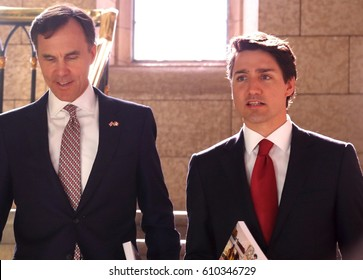 OTTAWA, CANADA - MARCH 22, 2017: Finance Minister Bill Morneau, left, and Prime Minister Justin Trudeau enter the House of Commons to present the Liberal government's 2017 budget.