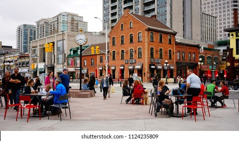 Ottawa, Canada - May 15, 2017. People sitting at outdoor coffee shop in Ottawa, Canada. Queen Victoria chose Ottawa as the capital of Canada in 1857.