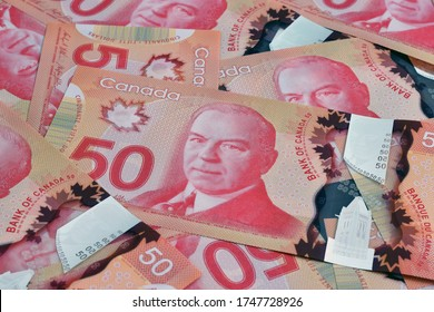 Ottawa, Canada - May 22, 2020: $50 (Fifty) Canadian dollar banknotes illustrative image concept for Canadian economic business development. It was introduced into circulation on March 26, 2012.