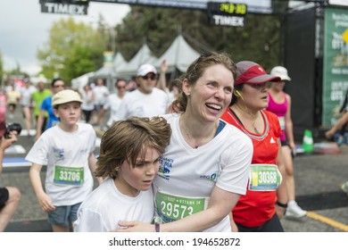 OTTAWA, CANADA - MAY 24, 2014: Unidentified participants finish the HTG SPORTS Ottawa 5K race as part of the Tamarack Ottawa Race weekend.