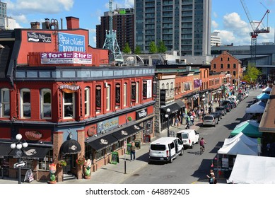 OTTAWA, CANADA - MAY 28, 2017:  People enjoy the popular restaurants and shops on William Street looking down from York in the historic Byward Market area.